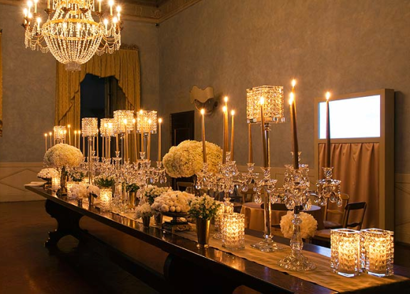 Crystal chandeliers, candlelight, warm golds