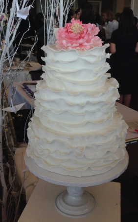 Ruffled cake topped with a sugar peony (Bean Counter)