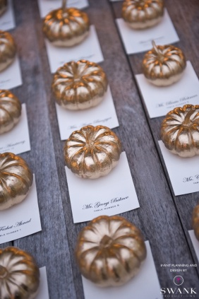 Gilded weights for escort cards (Swank Productions)